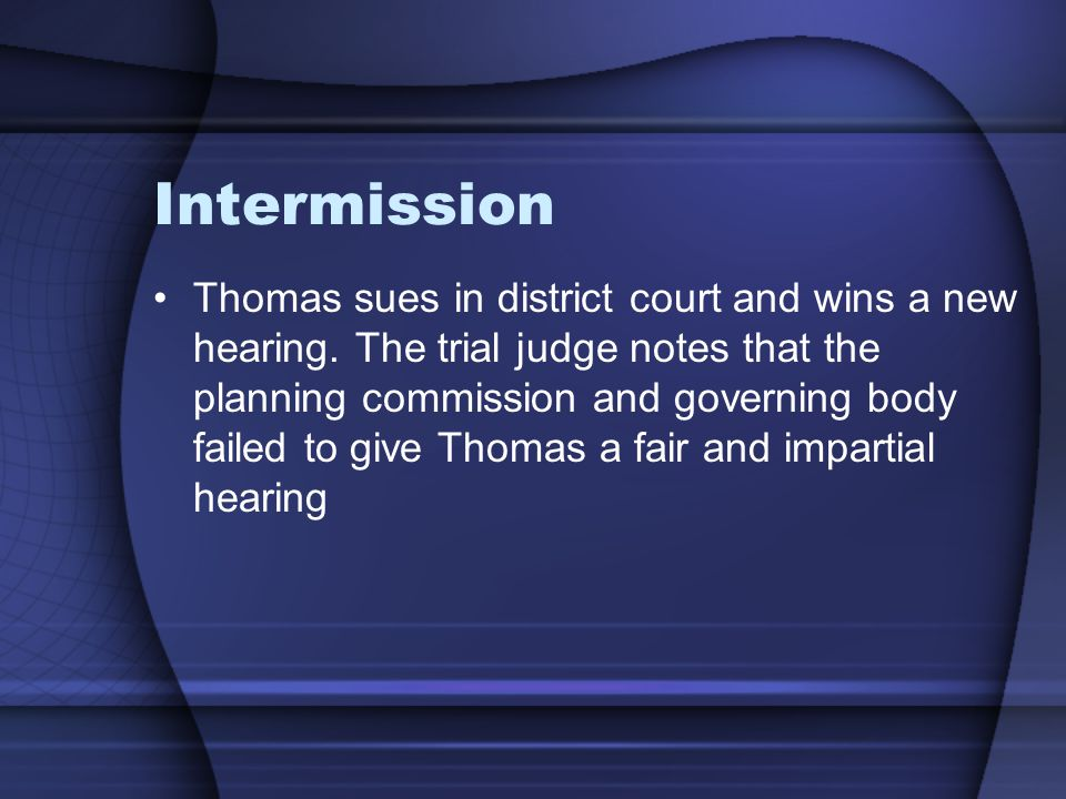 Intermission Thomas sues in district court and wins a new hearing.