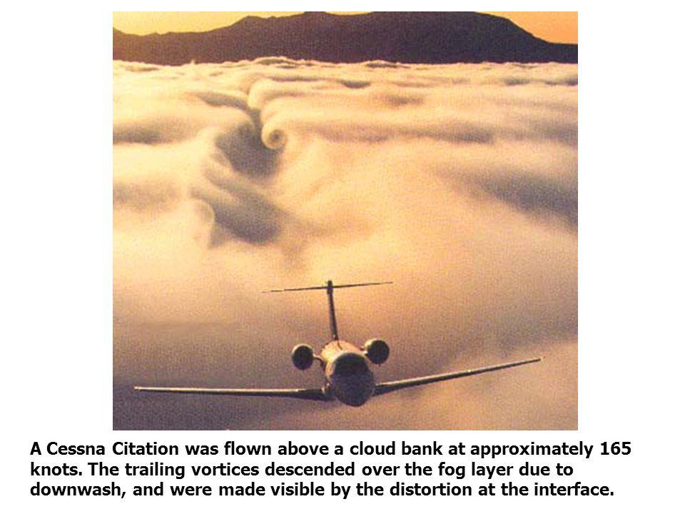 A Cessna Citation was flown above a cloud bank at approximately 165 knots.
