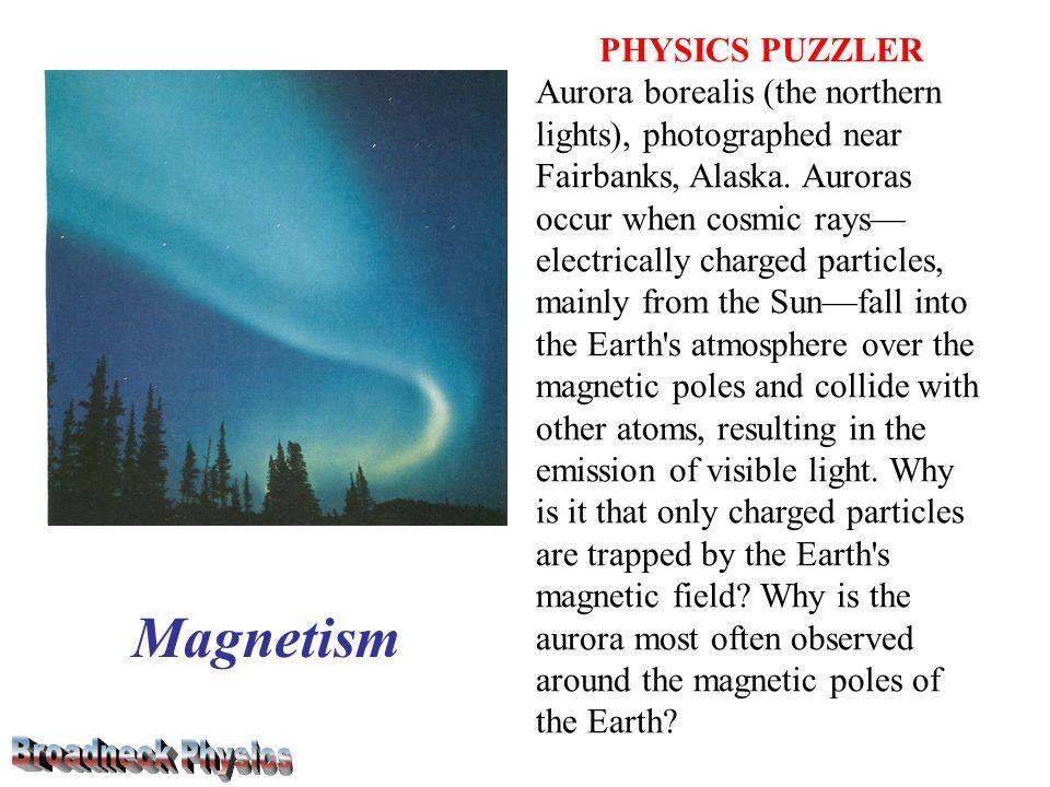 PHYSICS PUZZLER Aurora borealis (the northern lights), photographed near Fairbanks, Alaska.