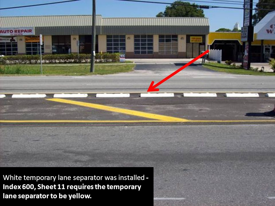 White temporary lane separator was installed - Index 600, Sheet 11 requires the temporary lane separator to be yellow.