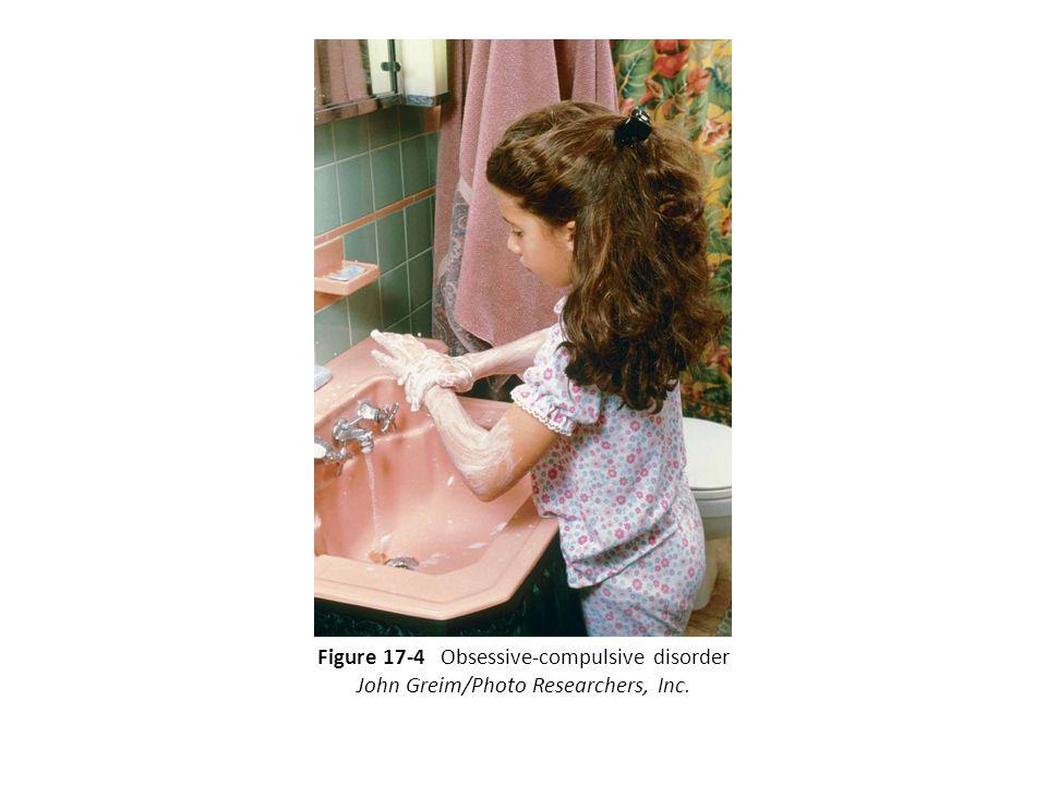 Figure 17-4 Obsessive-compulsive disorder John Greim/Photo Researchers, Inc.