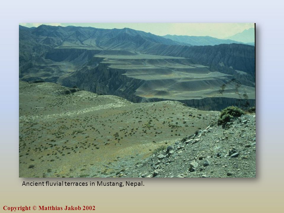 Copyright © Matthias Jakob 2002 Ancient fluvial terraces in Mustang, Nepal.