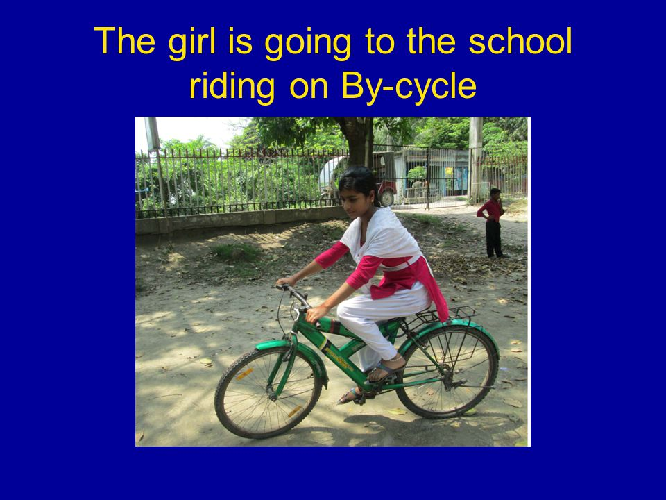 The girl is going to the school riding on By-cycle
