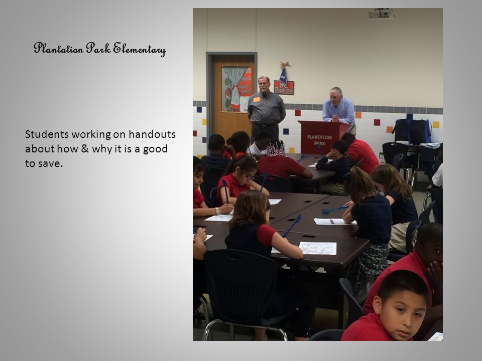 Plantation Park Elementary Students working on handouts about how & why it is a good to save.