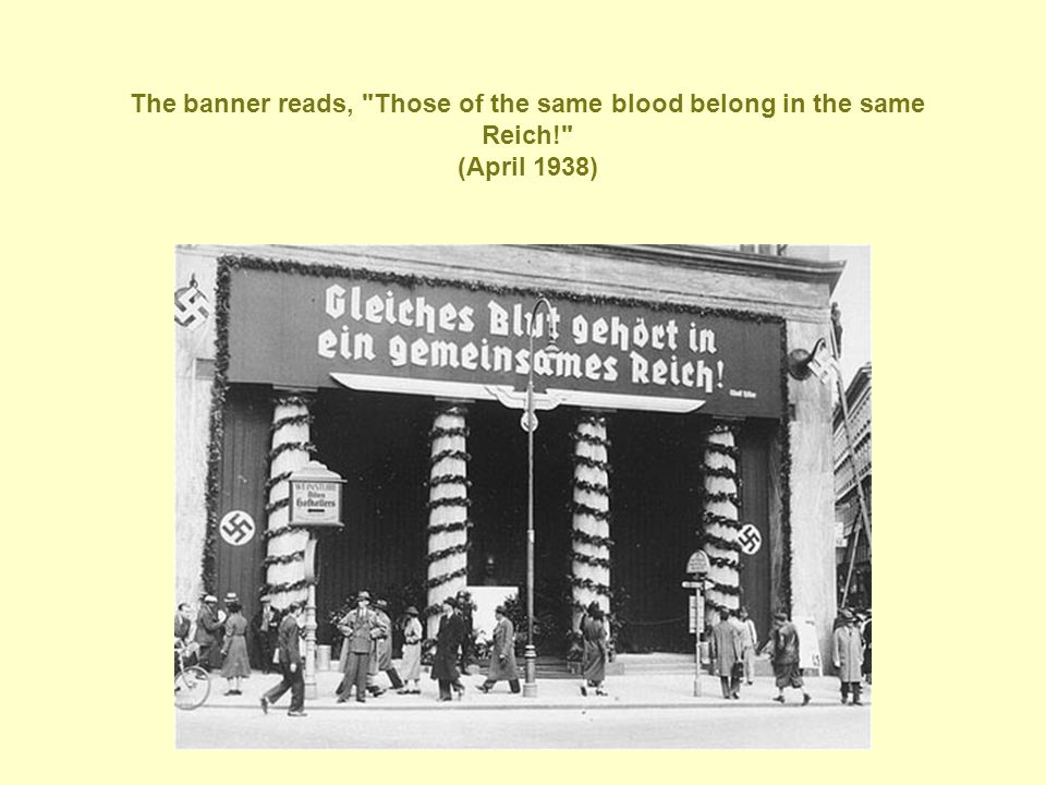 The banner reads, Those of the same blood belong in the same Reich! (April 1938)
