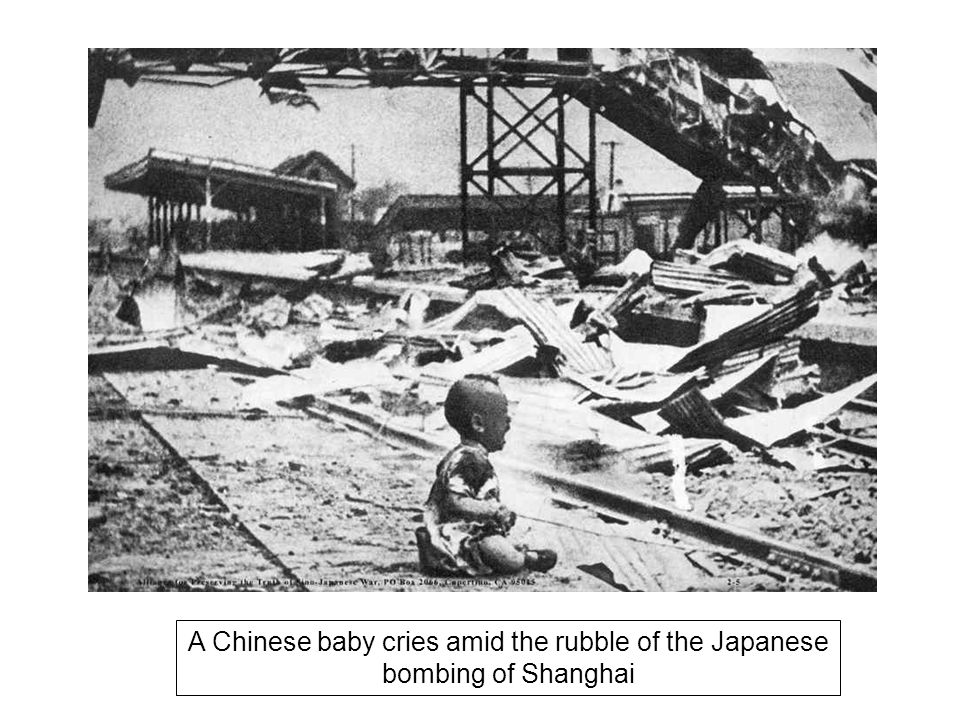 A Chinese baby cries amid the rubble of the Japanese bombing of Shanghai
