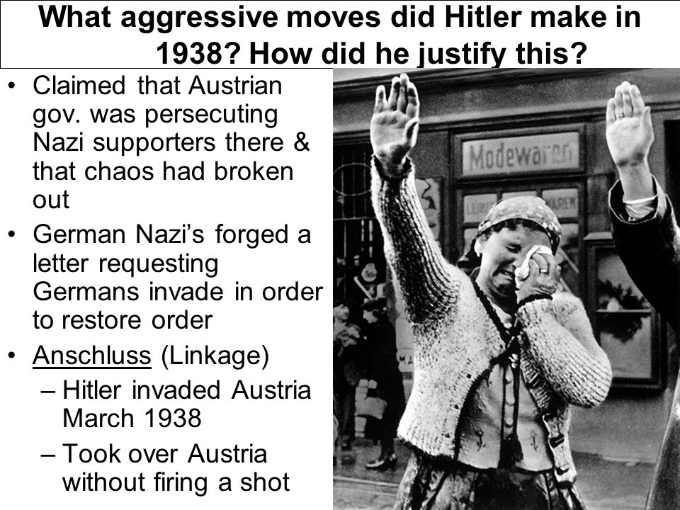 What aggressive moves did Hitler make in 1938. How did he justify this.