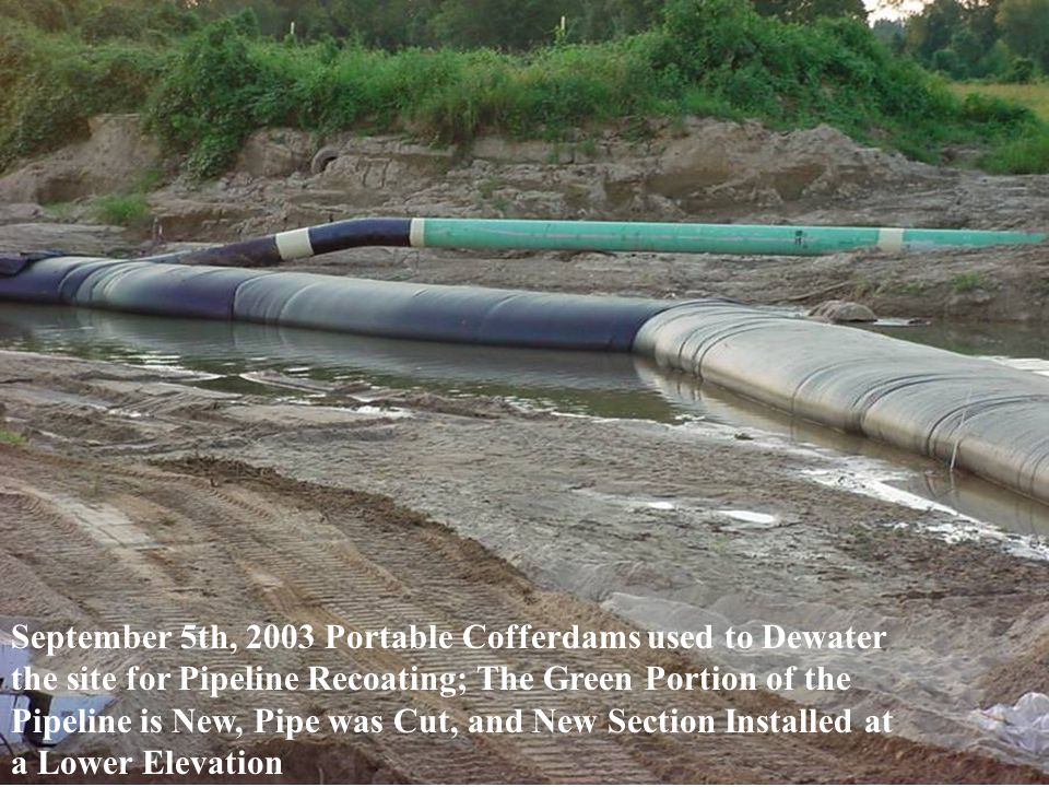 September 5th, 2003 Portable Cofferdams used to Dewater the site for Pipeline Recoating; The Green Portion of the Pipeline is New, Pipe was Cut, and New Section Installed at a Lower Elevation