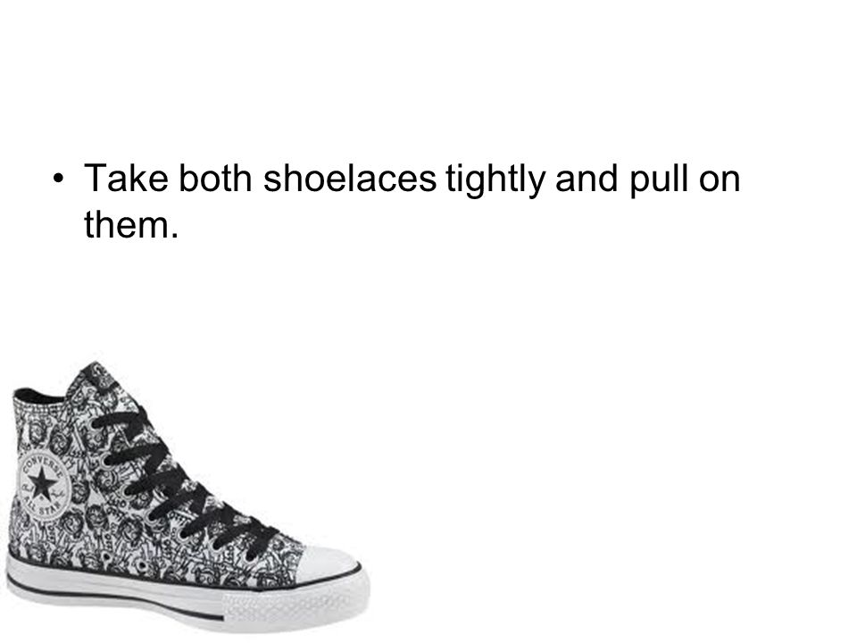 Take both shoelaces tightly and pull on them.