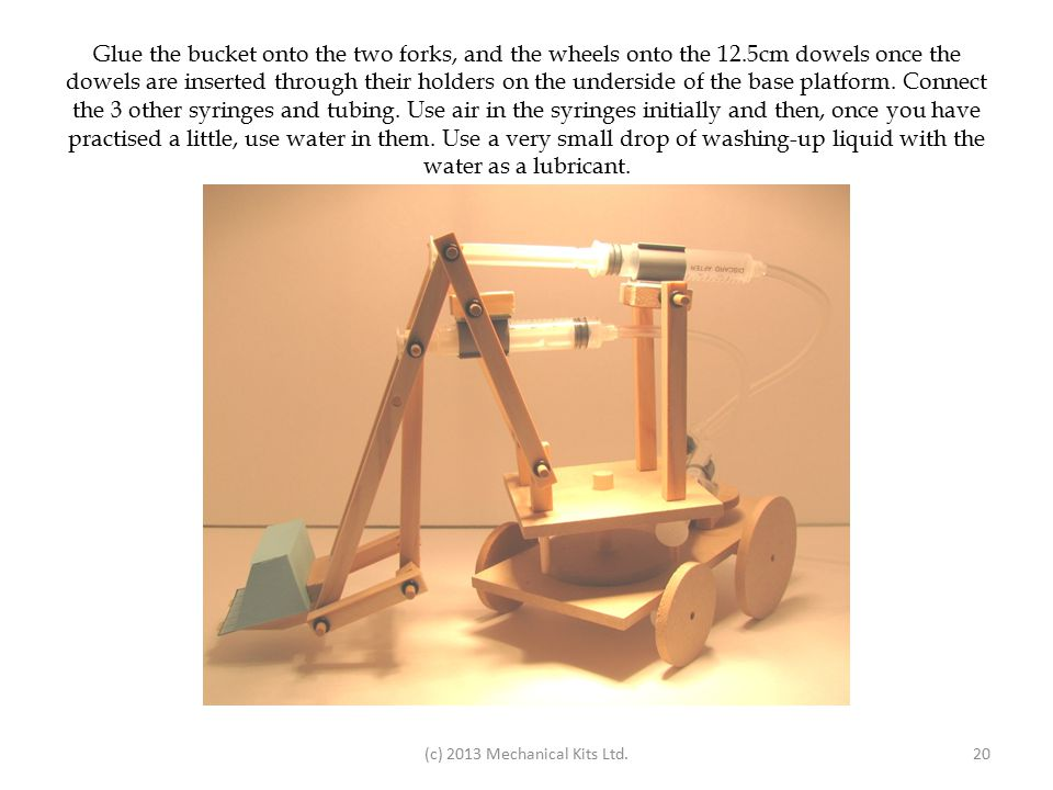 Glue the bucket onto the two forks, and the wheels onto the 12.5cm dowels once the dowels are inserted through their holders on the underside of the base platform.
