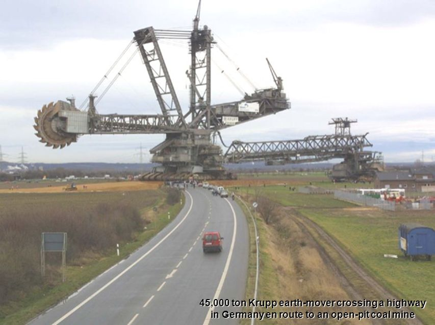 45,000 ton Krupp earth-mover crossing a highway in Germany en route to an open-pit coal mine
