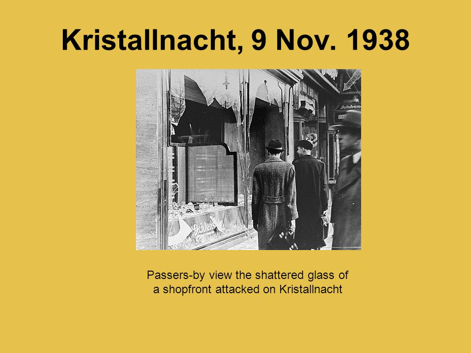 Kristallnacht, 9 Nov. 1938 Passers-by view the shattered glass of a shopfront attacked on Kristallnacht