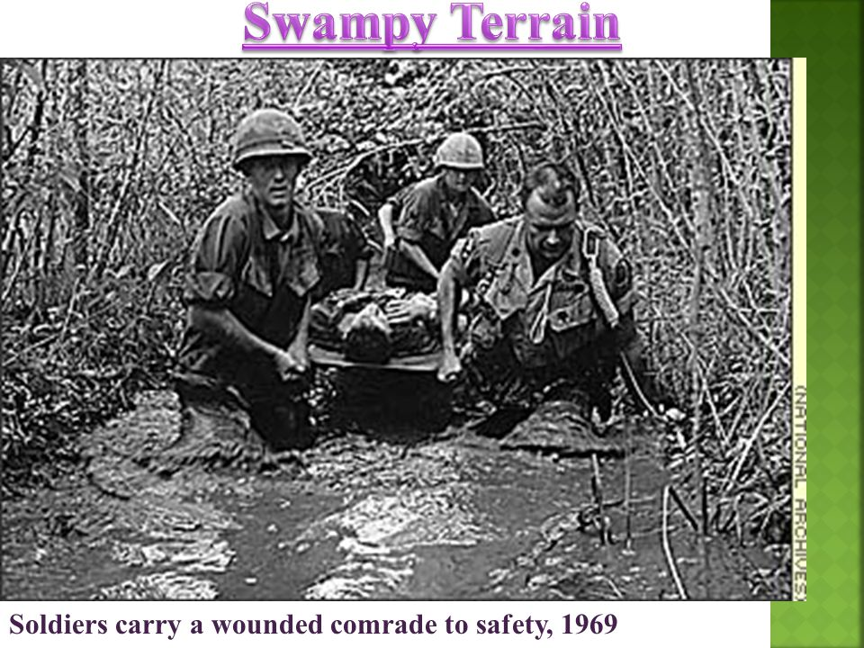 Soldiers carry a wounded comrade to safety, 1969