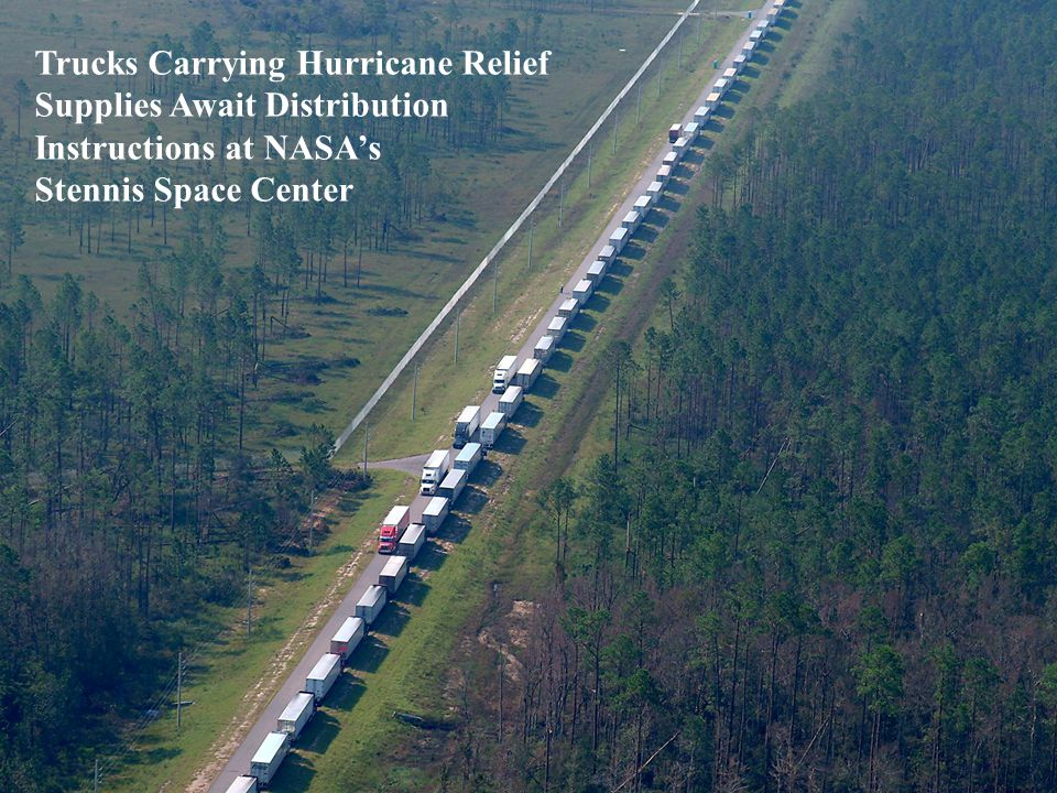 Trucks Carrying Hurricane Relief Supplies Await Distribution Instructions at NASA's Stennis Space Center