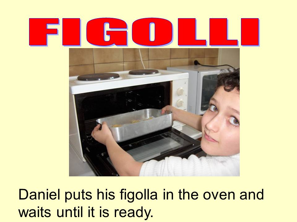 Daniel puts his figolla in the oven and waits until it is ready.