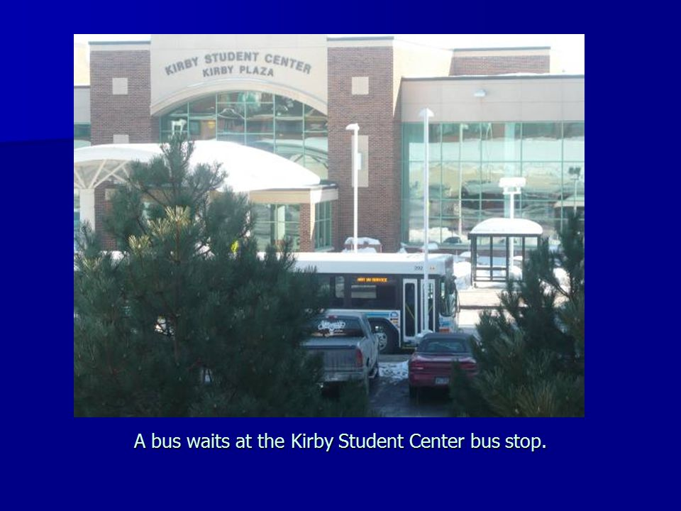 A bus waits at the Kirby Student Center bus stop.