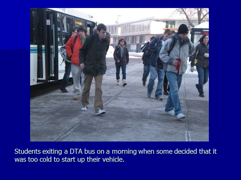 Students exiting a DTA bus on a morning when some decided that it was too cold to start up their vehicle.