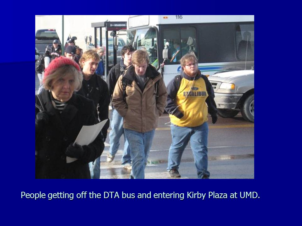 People getting off the DTA bus and entering Kirby Plaza at UMD.