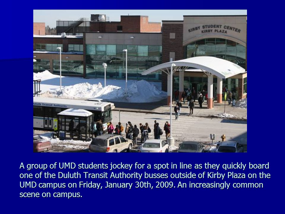 A group of UMD students jockey for a spot in line as they quickly board one of the Duluth Transit Authority busses outside of Kirby Plaza on the UMD c
