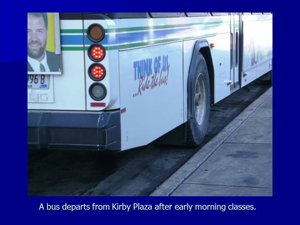 A bus departs from Kirby Plaza after early morning classes.