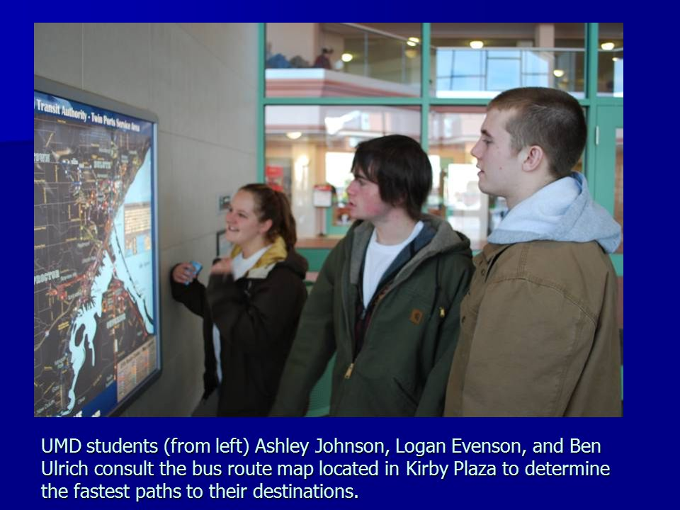 UMD students (from left) Ashley Johnson, Logan Evenson, and Ben Ulrich consult the bus route map located in Kirby Plaza to determine the fastest paths