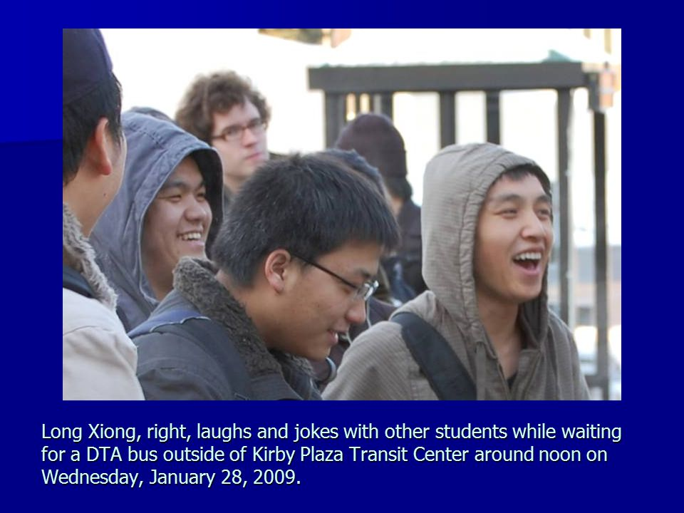 Long Xiong, right, laughs and jokes with other students while waiting for a DTA bus outside of Kirby Plaza Transit Center around noon on Wednesday, Ja