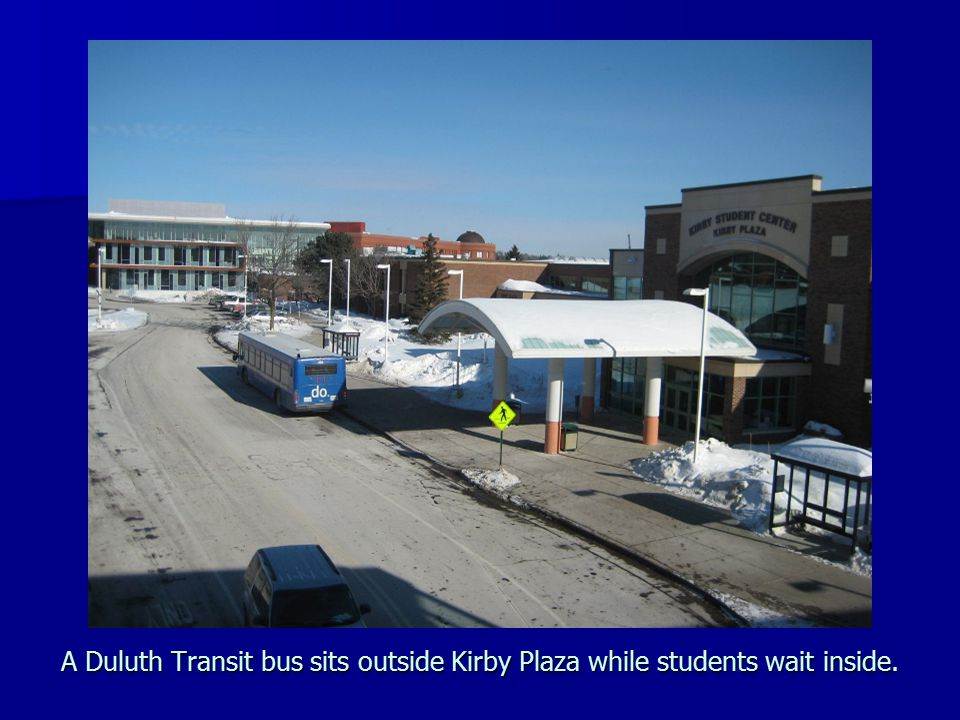 A Duluth Transit bus sits outside Kirby Plaza while students wait inside.