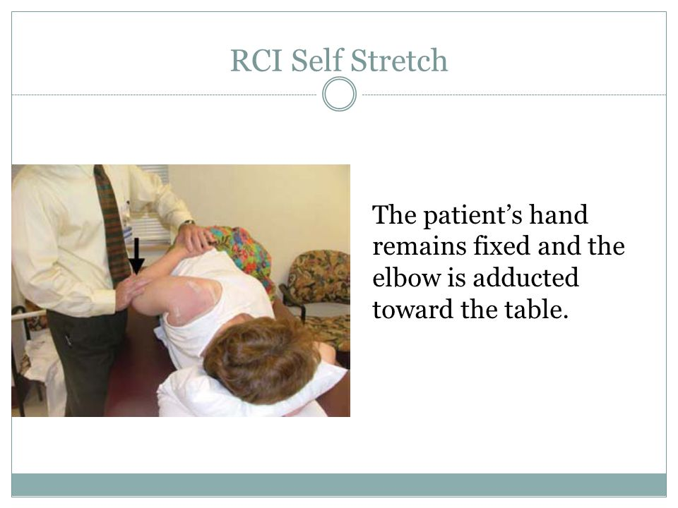 RCI Self Stretch The patient's hand remains fixed and the elbow is adducted toward the table.