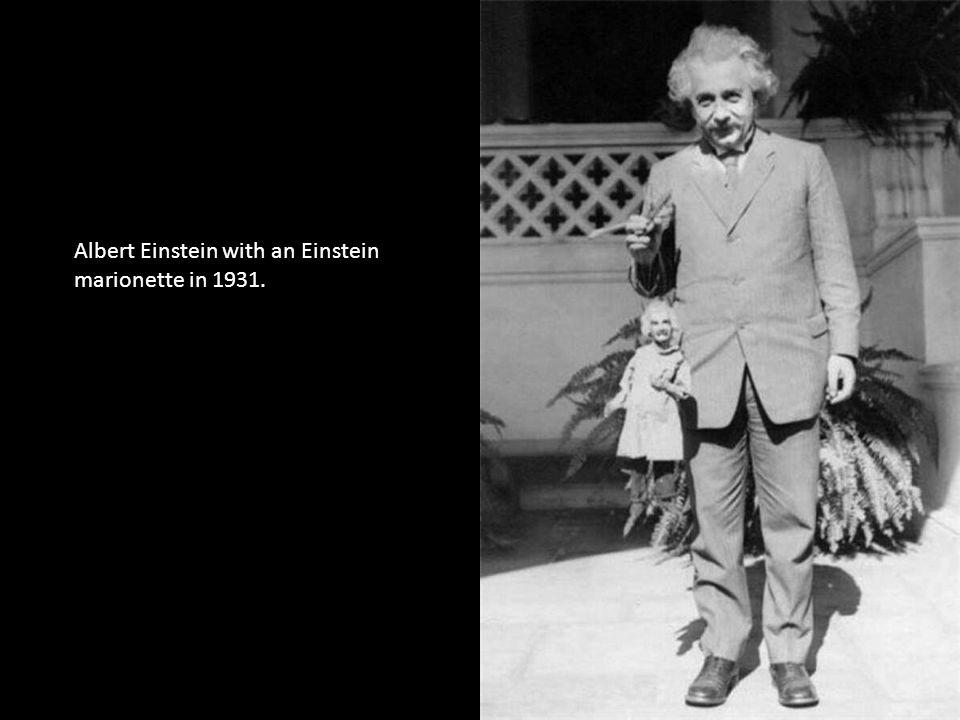 Albert Einstein with an Einstein marionette in 1931.