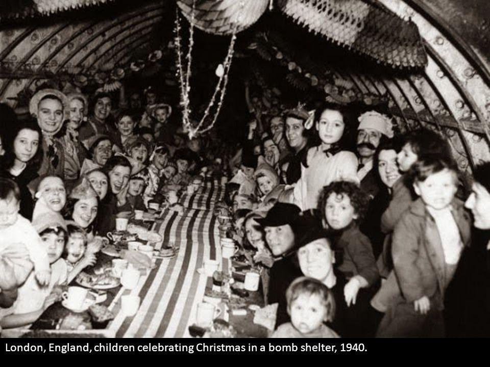 London, England, children celebrating Christmas in a bomb shelter, 1940.