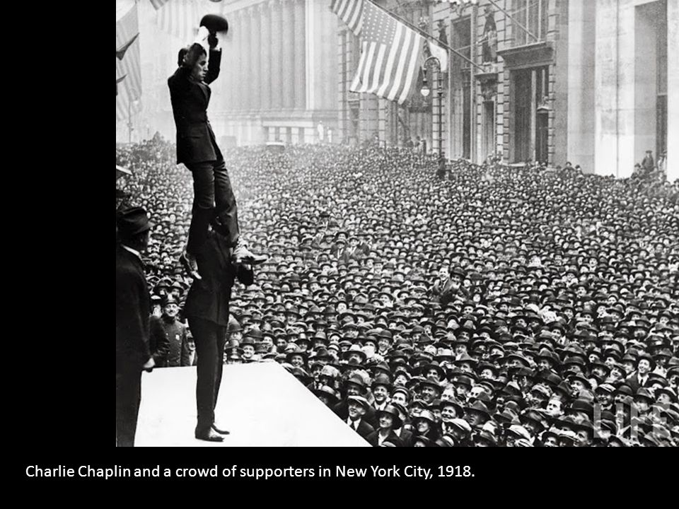 Charlie Chaplin and a crowd of supporters in New York City, 1918.