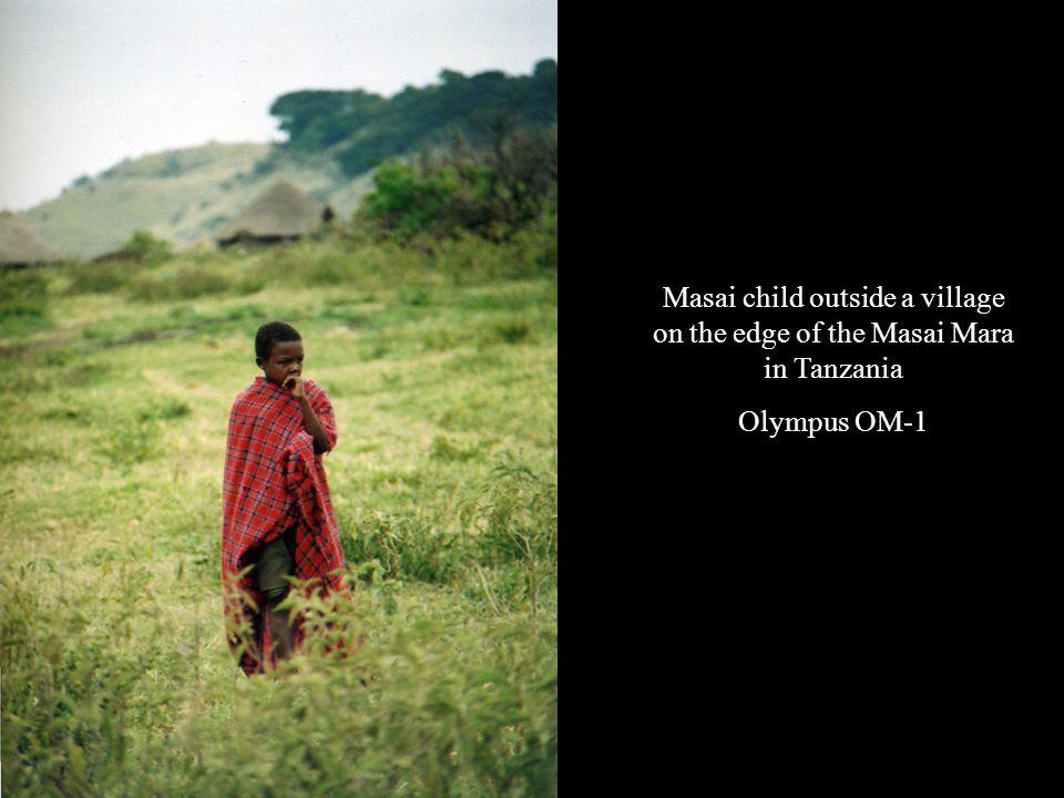 Masai child outside a village on the edge of the Masai Mara in Tanzania Olympus OM-1