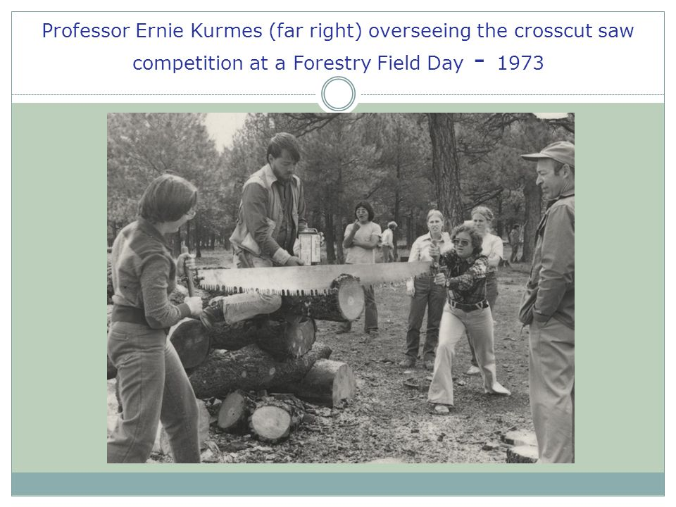Professor Ernie Kurmes (far right) overseeing the crosscut saw competition at a Forestry Field Day - 1973