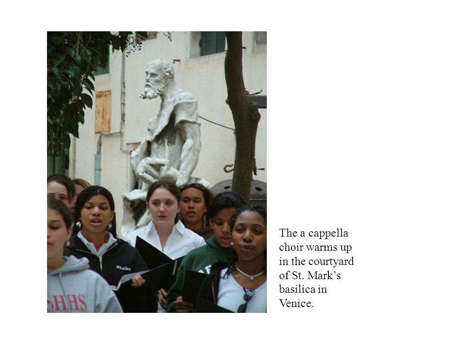 The a cappella choir warms up in the courtyard of St. Mark's basilica in Venice.
