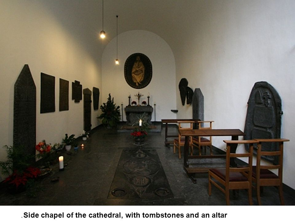 Side chapel of the cathedral, with tombstones and an altar.