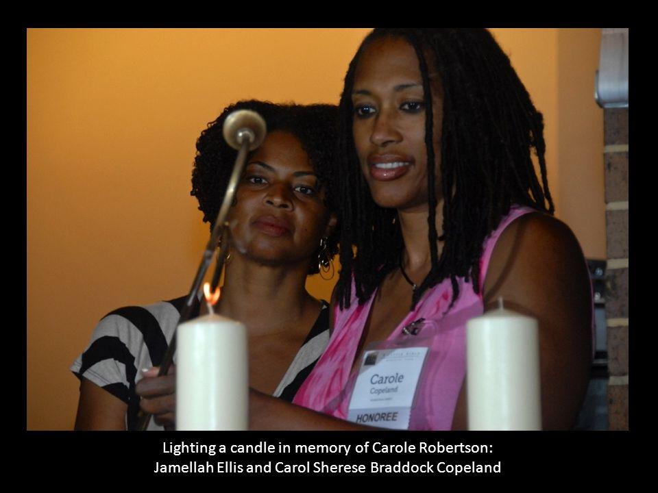 Lighting a candle in memory of Carole Robertson: Jamellah Ellis and Carol Sherese Braddock Copeland