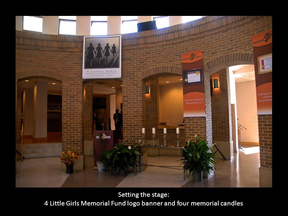 Setting the stage: 4 Little Girls Memorial Fund logo banner and four memorial candles