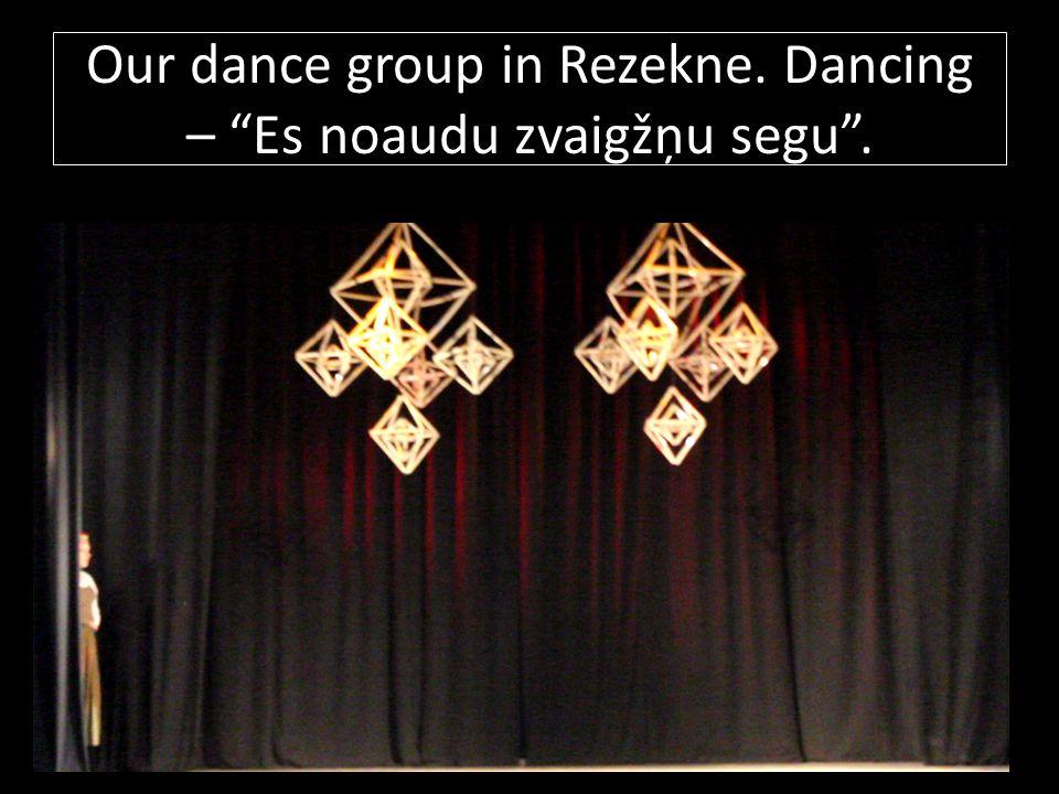 """Our dance group in Rezekne. Dancing – """"Es noaudu zvaigžņu segu""""."""