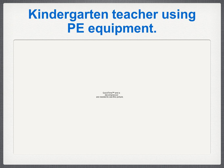 Kindergarten teacher using PE equipment.