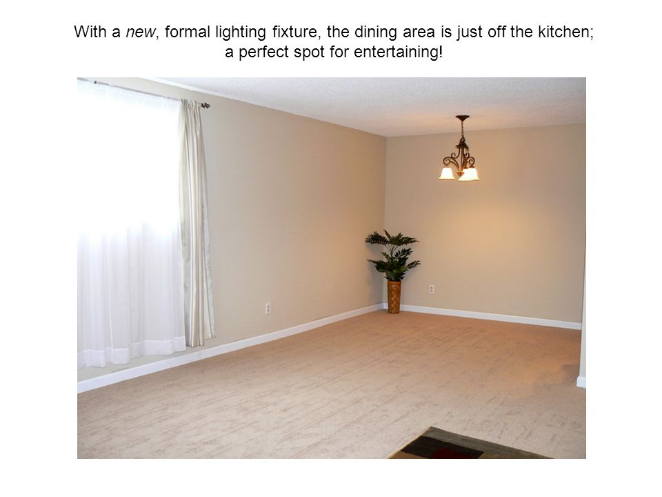 With a new, formal lighting fixture, the dining area is just off the kitchen; a perfect spot for entertaining!