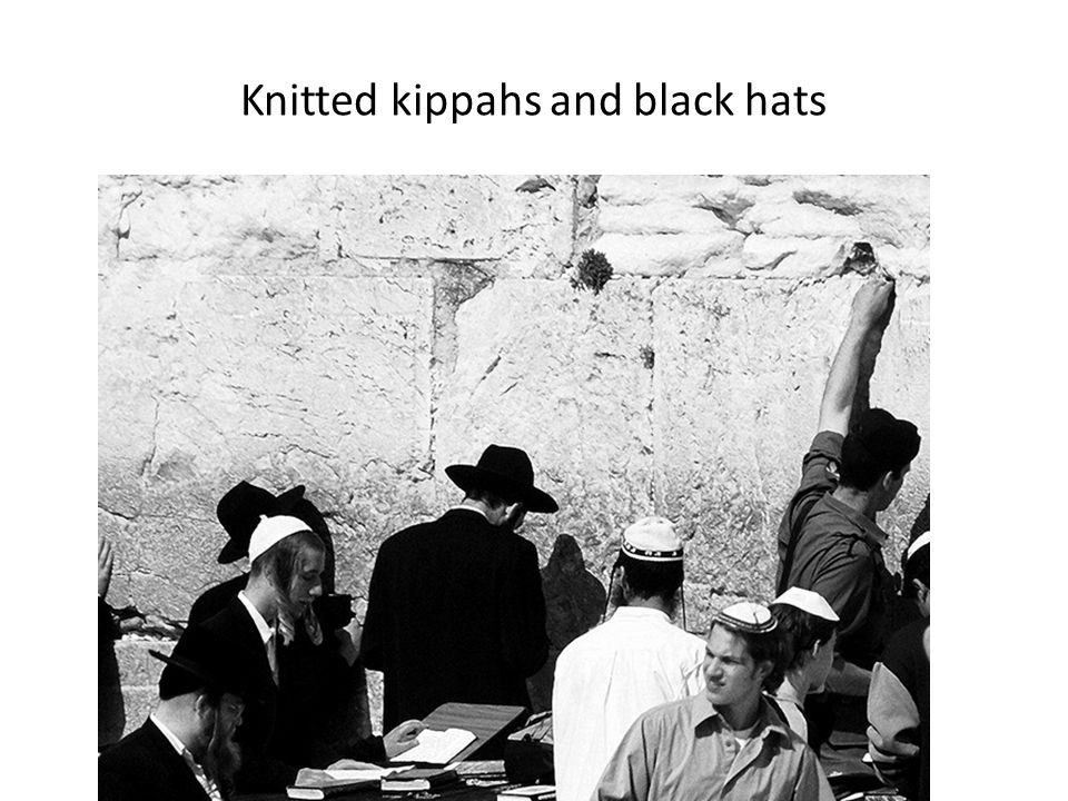 Knitted kippahs and black hats