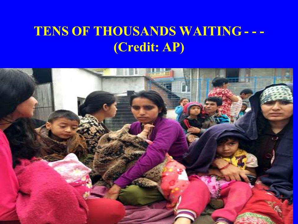 TENS OF THOUSANDS WAITING - - - (Credit: AP)