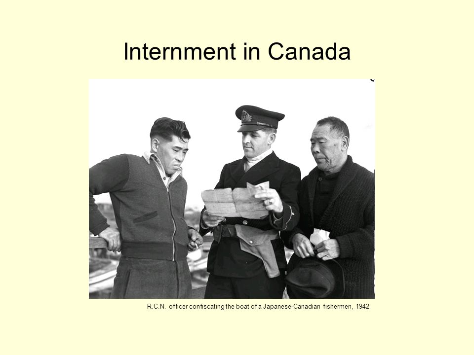 Internment in Canada R.C.N. officer confiscating the boat of a Japanese-Canadian fishermen, 1942