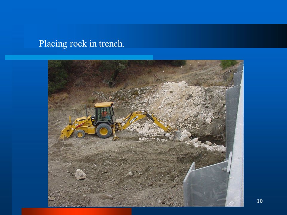 10 Placing rock in trench.