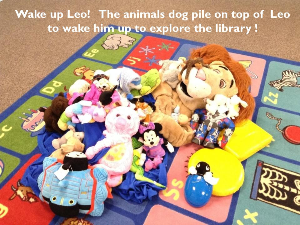 Wake up Leo! The animals dog pile on top of Leo to wake him up to explore the library !