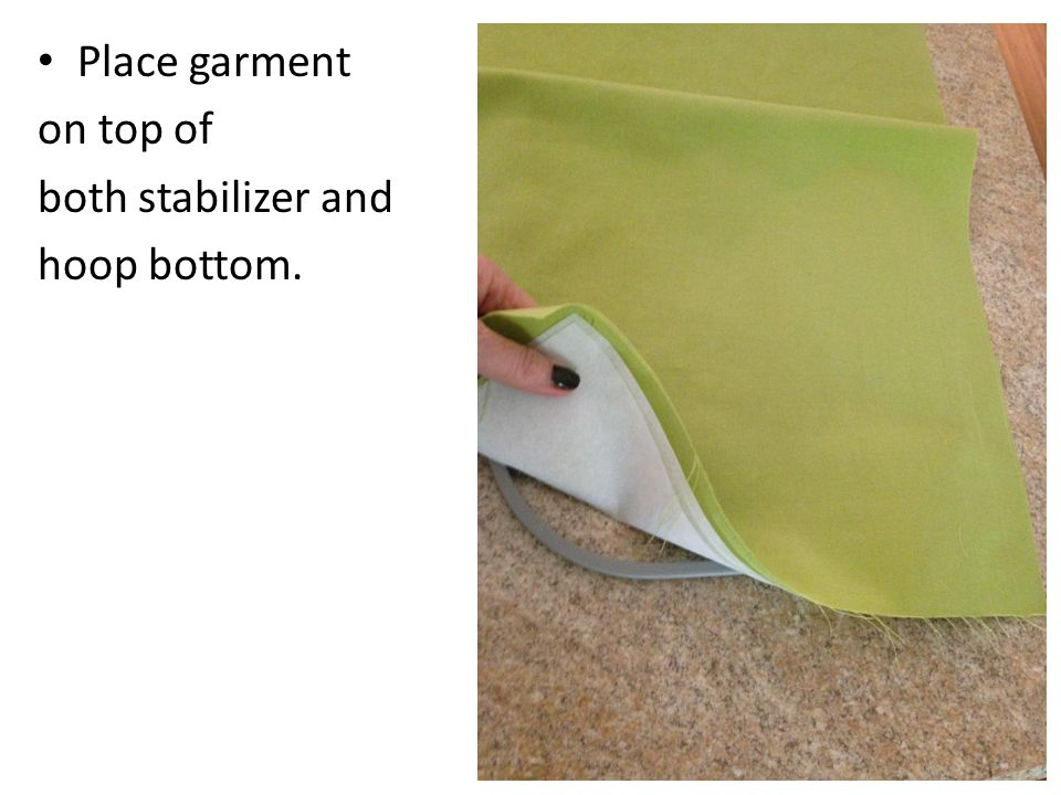 Place garment on top of both stabilizer and hoop bottom.