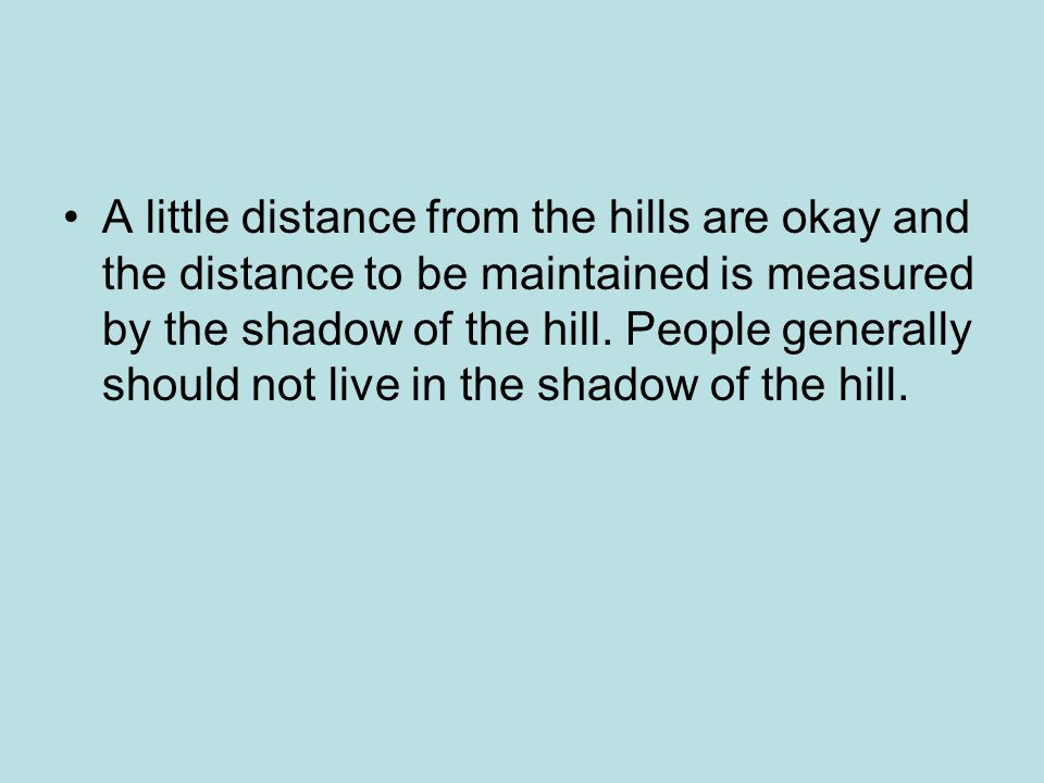 A little distance from the hills are okay and the distance to be maintained is measured by the shadow of the hill.