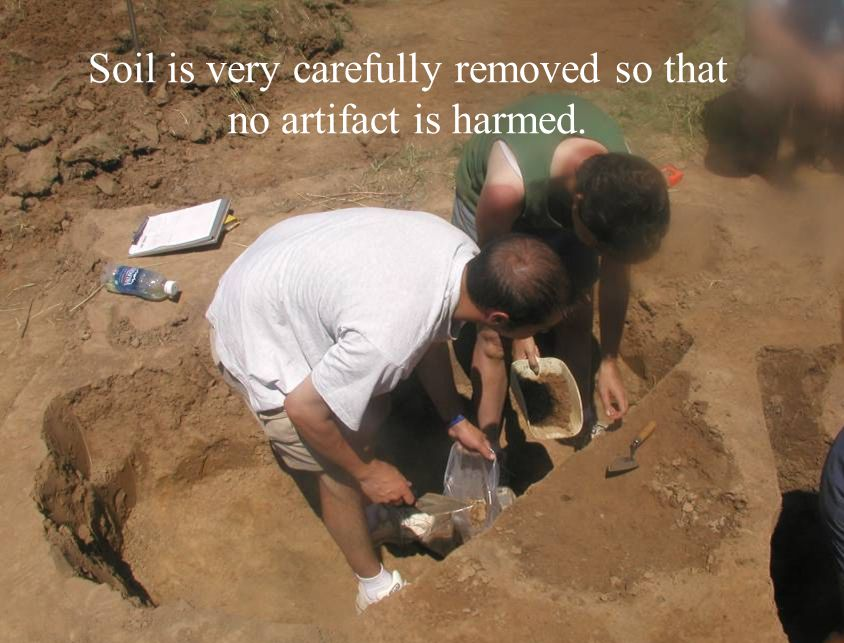 Soil is very carefully removed so that no artifact is harmed.