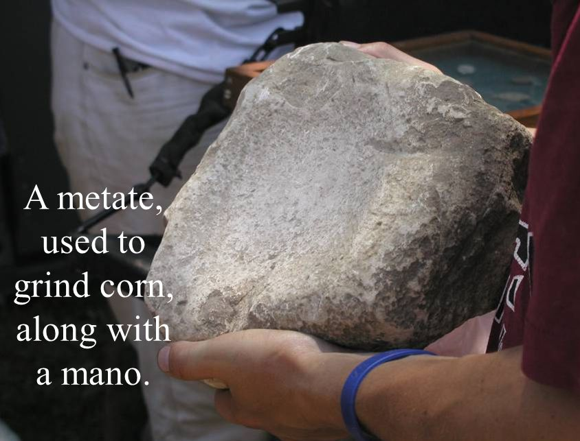 A metate, used to grind corn, along with a mano.