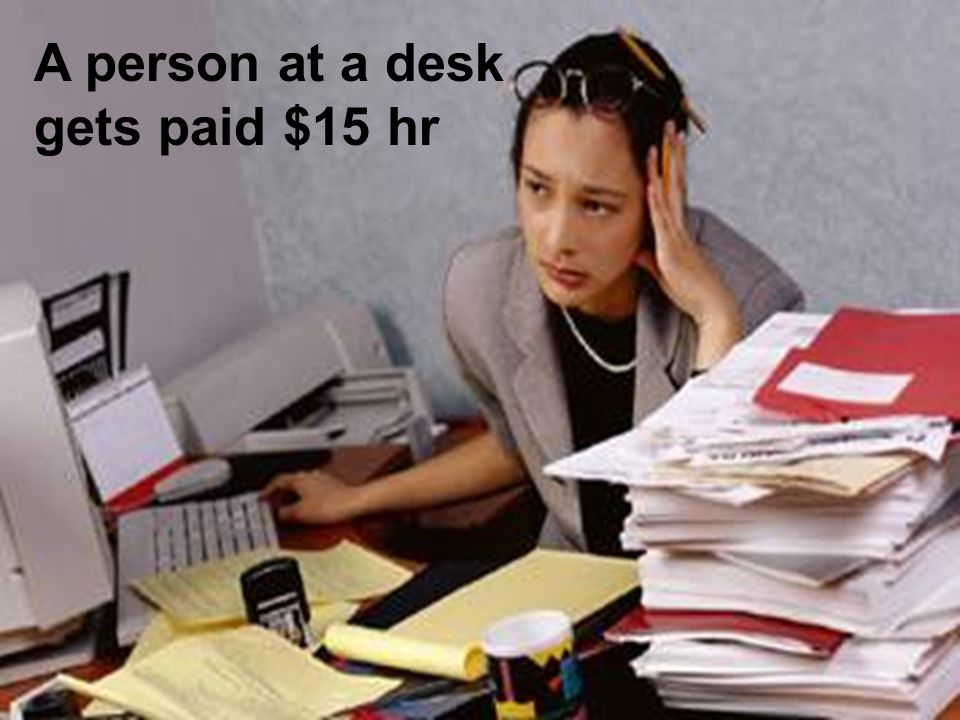 A person at a desk gets paid $15 hr